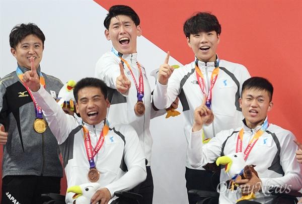 남북장애인아주대회2018-첫동메달.jpg